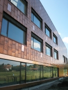 <h5>Collège D'Apples : Façades et toiture ventilées en revêtement cuivre propre fabrication</h5>